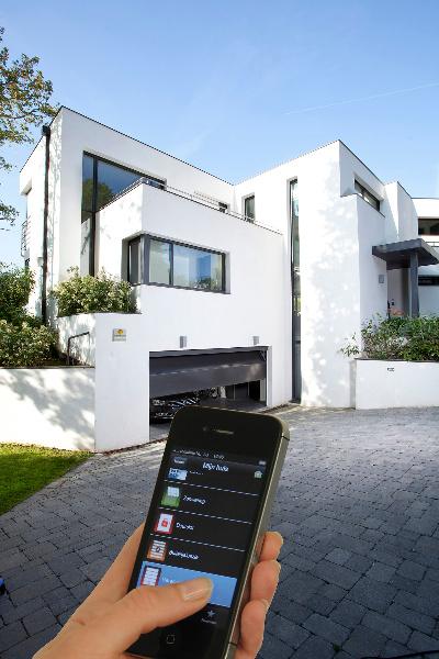 Prot gez l habitation de votre client gr ce la domotique for Comment ouvrir une porte de garage automatique